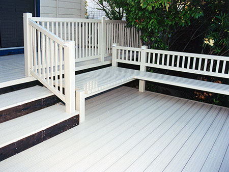 vinyl rail with built-in bench on brock deck