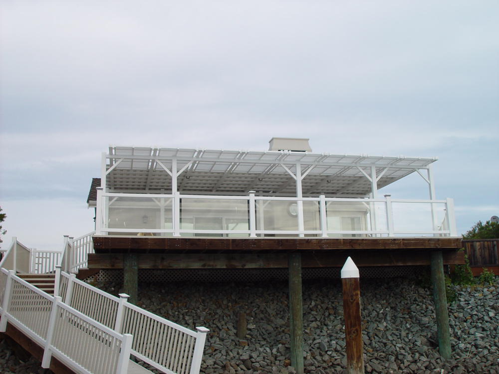 Deck with glass railing and patio cover